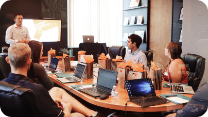 IT workers meeting around conference table